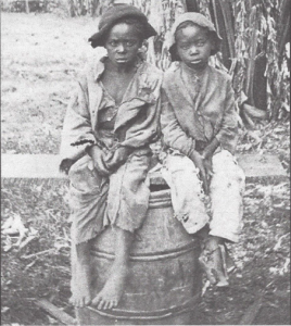 Slave Children. A haunting, undated 150 year old photo found in a Charlotte, North Carolina  attic during a moving sale. It may have been taken in the early 1860's and is surely a testament to the dark side of American History. A document accompanying the photo detailed the sale of John for $1,500, not a small sum in 1854. He is barefoot,  clothed in rags perched on a barrel next to an unidentified young boy. A New York collector paid $30,00 for the photo album including John. The deceased owner of the home where the photo was found was thought to be a descendant of John.