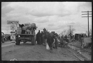 Sharecroppers along highway with truck