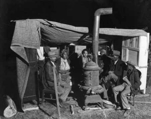 Sharecroppers huddled around stove