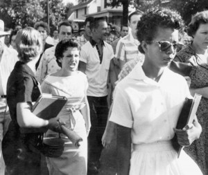"Segregationist protestors surround Elizabeth Eckford as she attempts to integrate Central High School in Little Rock, Arkansas, 1957. Reflecting on the experience decades later, Ms. Eckford observed, ""True reconciliation can occur only when we honestly acknowledge our painful, but shared past."